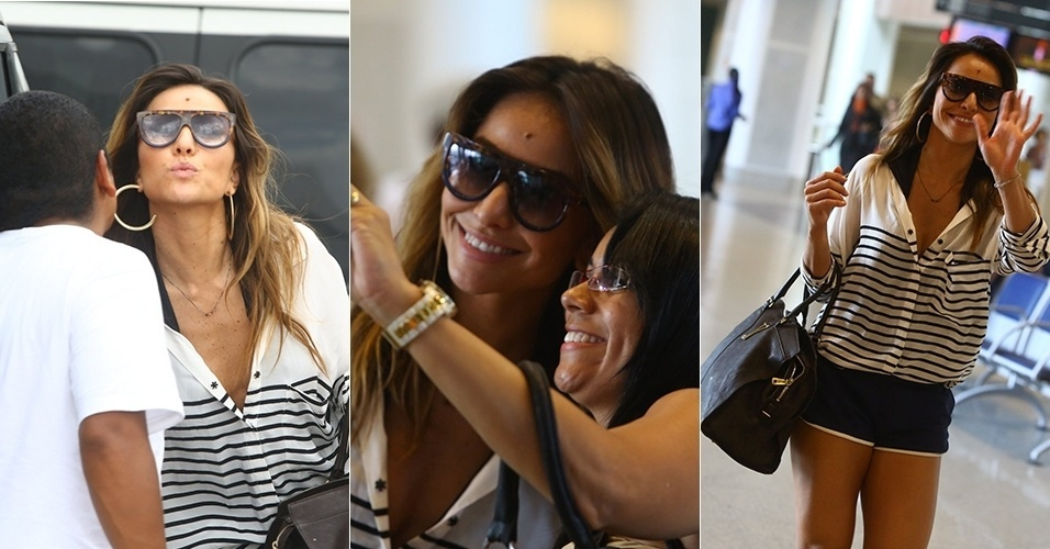 17.mar.2013 - Sabrina Sato mostra simpatia com fãs e paparazzi em aeroporto no Rio de Janeiro