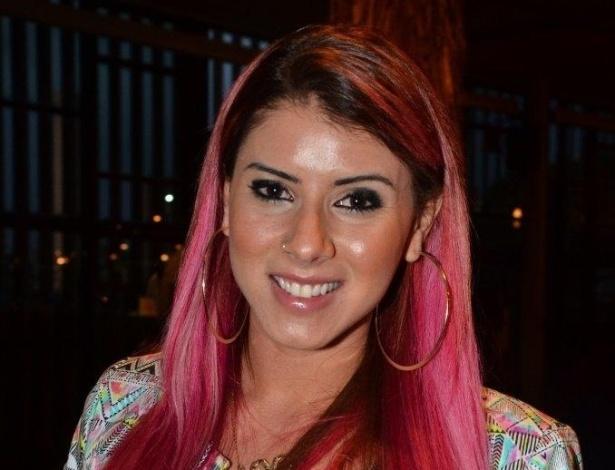 21.mar.2013 - A panicat Thaís Bianca no quarto dia de desfiles da São Paulo Fashion Week Verão 2014 que acontece na Bienal, em São Paulo