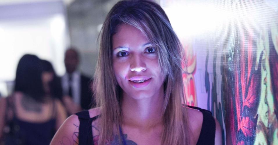 23.mar.2013 - A empresária Manuela Barbosa visita a 8ª edição da São Paulo Tattoo Festival, convenção de tatuagem que reúne artistas e admiradores no centro de São Paulo, neste sábado (23) e domingo (24)