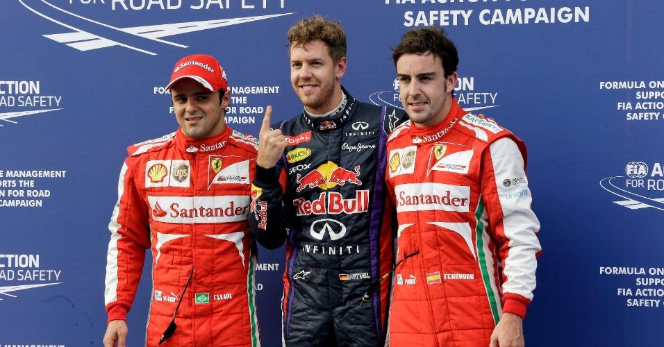 23.mar.2013 - Pole do GP da Malásia, Sebastian Vettel posa ao lado de Felipe Massa (2º) e Fernando Alonso (3º)