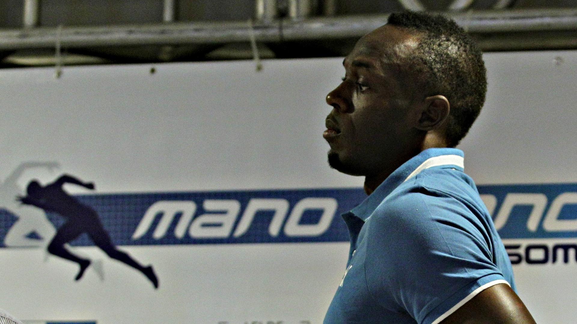 28.mar.2013 - Usain Bolt deixa a coletiva no Rio de Janeiro; ele declarou que já sabe da interdição no Engenhão, mas que acreditar que há tempo para que tudo seja resolvido