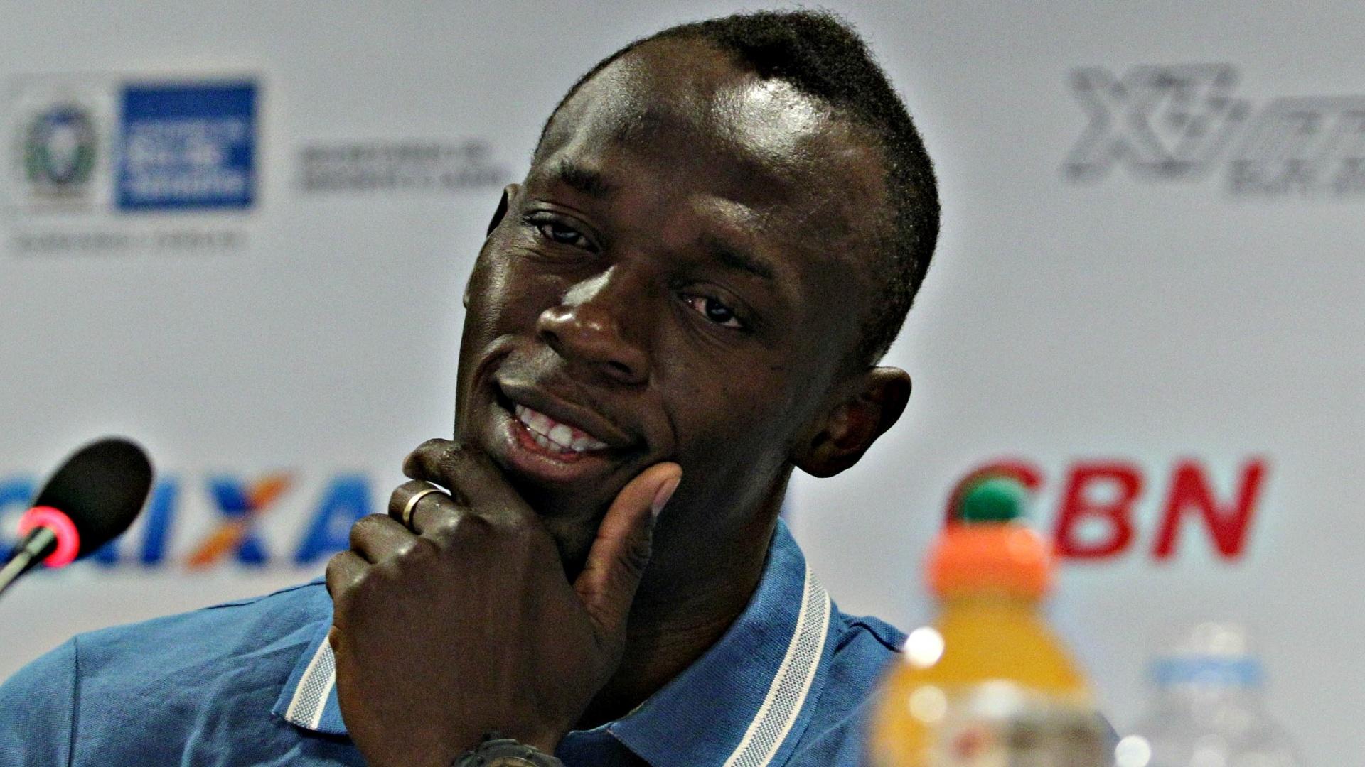 28.mar.2013 - Usain Bolt sorri antes de responder à pergunta durante entrevista coletiva no Rio de Janeiro