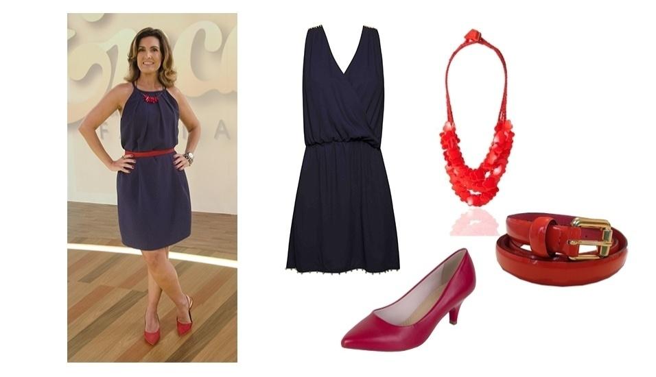O discreto vestido azul usado por Fátima Bernardes é elegante e abriu espaço para os acessórios vermelhos chamarem a atenção