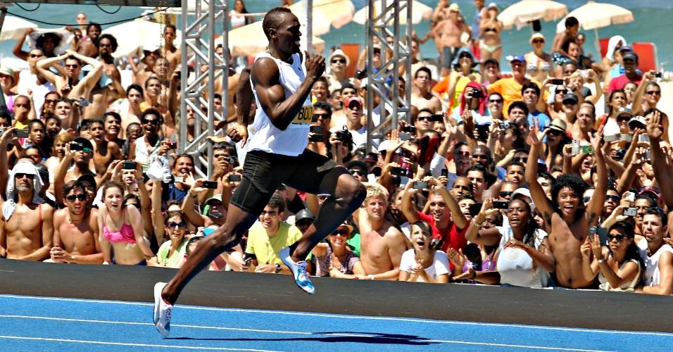 31.mar.2013 - Usain Bolt corre para vencer desafio de 150 m rasos no Rio de Janeirio; jamaicano não bateu recorde