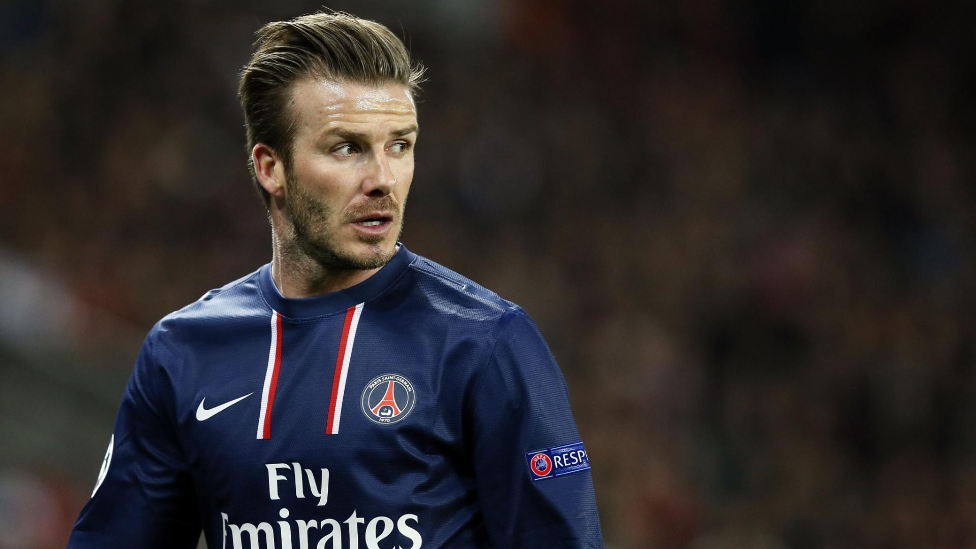 02.abr.2013- David Beckham observa jogo durante duelo entre PSG e Barcelona pelas quartas de final da Liga dos Campeões