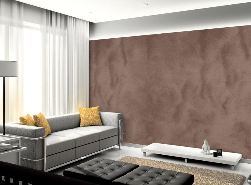 Na sala de estar, destaque para a parede lateral com acabamento de efeito camurça, das Tintas Suvinil