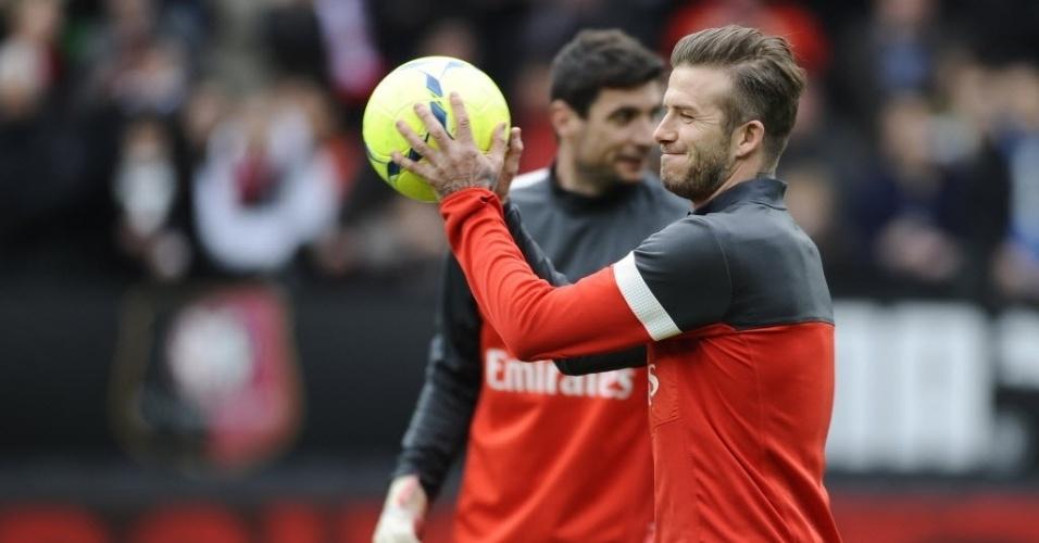 06.abr.2013 - David Beckham faz o aquecimento antes da partida do PSG contra o Rennes, pelo Campeonato Francês