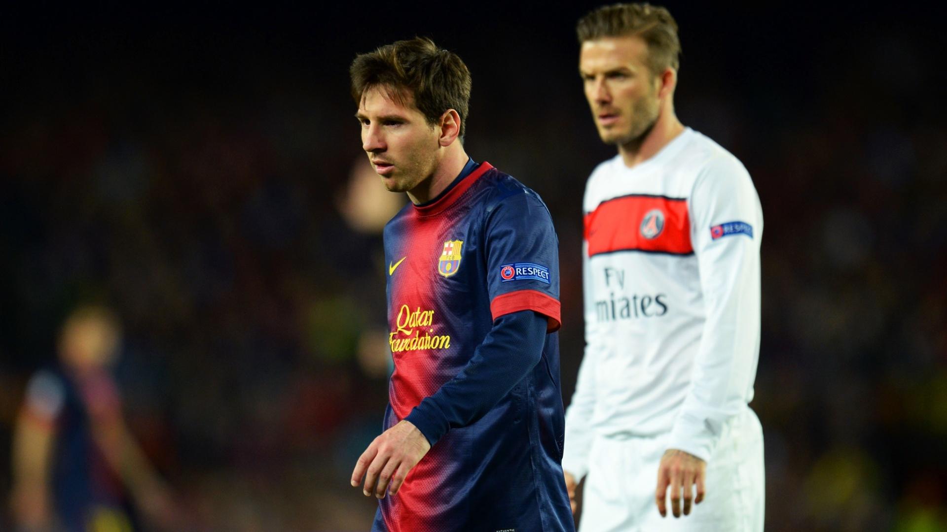 10.abr.2013- Messi e David Beckham durante jogo entre Barcelona e PSG pelas quartas de final da Liga dos Campeões