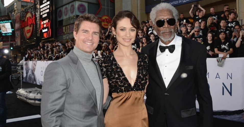"11.abr.2013 - Tom Cruise, Morgan Freeman e Olga Kurylenko na pré-estreia do filme ""Oblivion"" no tradicional Dolby Theatre em Hollywood (EUA). O protagonista do filme está fazendo uma turnê mundial para divulgação do longa, e já passou pelo Rio de Janeiro"