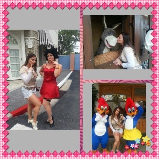 24.abr.2013 - Se achando, a modelo Vivi Araújo posa ao lado dos personagens da Disney, nos EUA