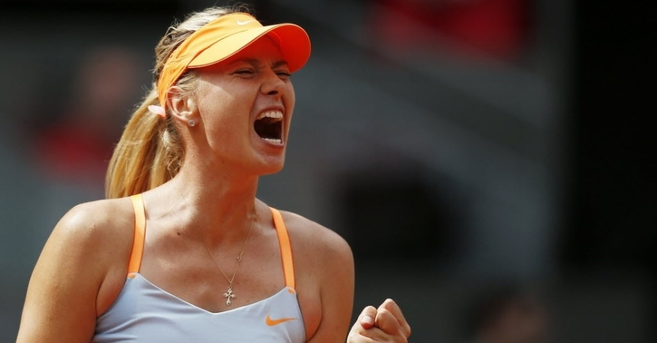 09.mai.2013 - Maria Sharapova grita aps conquistar ponto na partida contra a alem Sabine Lisicki em Madri