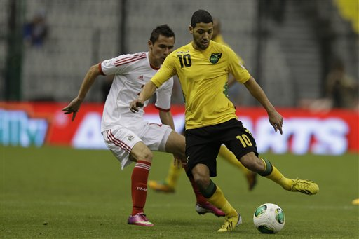 Jamaica's Joel McAnuff, front, is chased by Mexico's Paul Nicolas Aguilar during a World Cup 2014 qualifying match at the Aztec stadium in Mexico City, Wednesday, Feb. 6, 2013. (AP Photo/Dario Lopez-Mills)