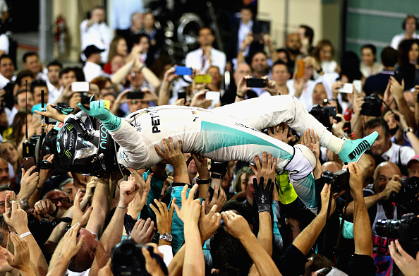 ABU DHABI, UNITED ARAB EMIRATES - NOVEMBER 27: Nico Rosberg of Germany and Mercedes GP celebrates after finishing second and winning the World Drivers Championship during the Abu Dhabi Formula One Grand Prix at Yas Marina Circuit on November 27, 2016 in Abu Dhabi, United Arab Emirates. (Photo by Clive Mason/Getty Images)