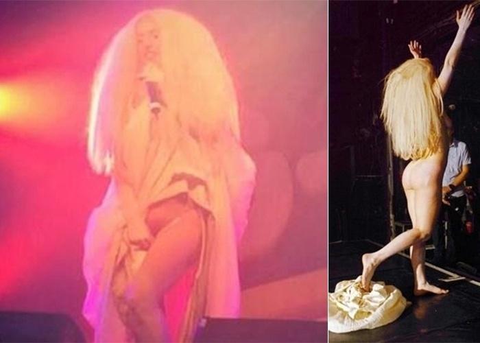 """28.out.2013 - Lady Gaga continua roubando a cena por onde passa. No último sábado (26), a cantora tirou a roupa durante uma apresentação em uma boate de Londres, em uma apresentação do novo single """"Venus"""". No palco, a cantora puxou seu vestido para cima e abaixou a calcinha, deixando suas partes íntimas à mostra para o público. Depois que a música acabou, ela virou de costas para o público e tirou o vestido, ficando totalmente nua enquanto deixava o palco."""
