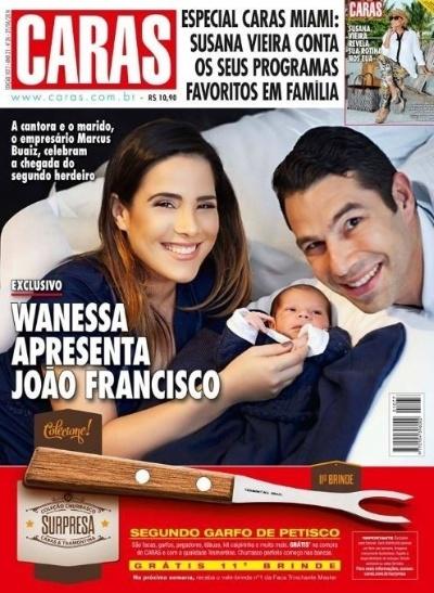 24.jun.2014 - Ao lado do marido, o empresário Marcus Buaiz, Wanessa mostra o pequeno João Francisco à revista Caras