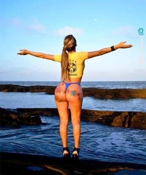 26.jun.2014 - Thalita Zampirolli, a modelo transex que foi fotografada ao lado de Romário na saída de uma balada no Rio, faz ensaio inspirado no Mundial esbanjando suas curvas