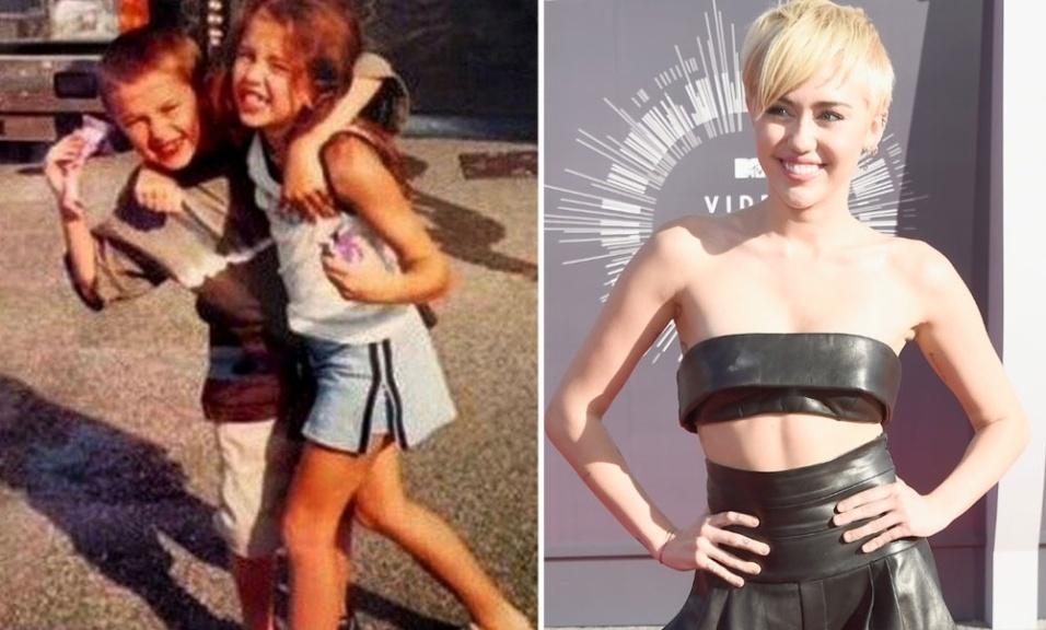 12.out.2014 - Não é Dia das Crianças nos Estados Unidos, mas coincidentemente a cantora Miley Cyrus compartilhou uma foto de sua infância neste domingo, ao lado do irmão Braison
