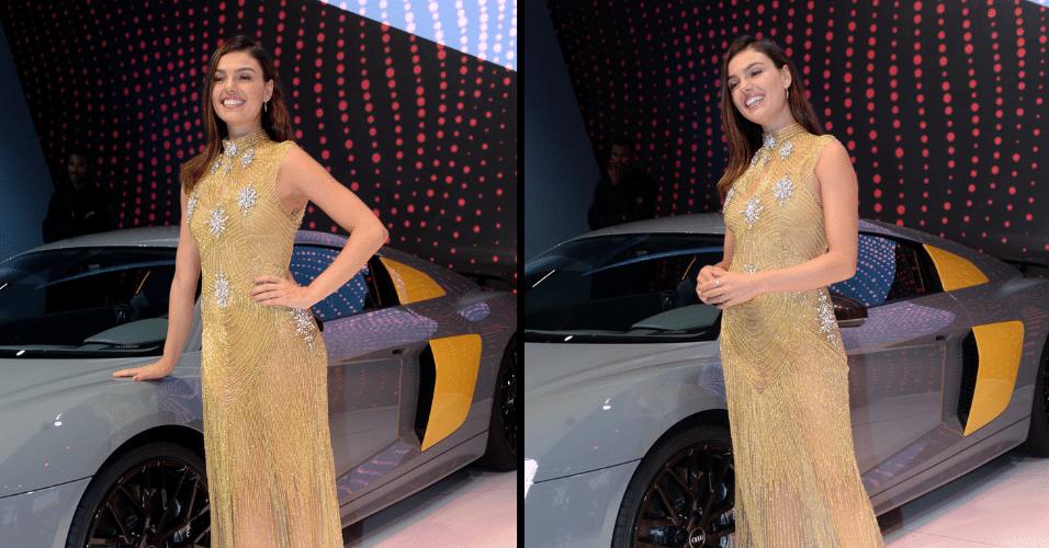 8.nov.2016 - A atriz Ísis Valverde apresentou modelo esportivo da Audi no Salão do Automóvel 2016, em São Paulo