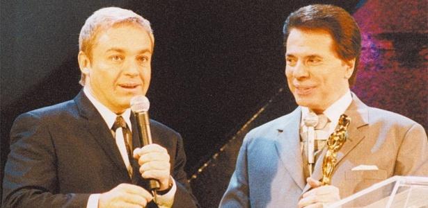 http://imguol.com/c/entretenimento/2013/06/12/os-apresentadores-de-tv-gugu-liberato-a-esq-do-domingo-legal-e-silvio-santos-na-entrega-do-trofeu-imprensa-programa-do-sbt-1371075985543_615x300.jpg