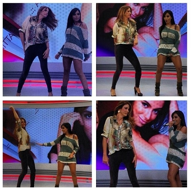 """20.jun.2013 - Ticiane Pinheiro e a funkeira Anitta dançam juntas no palco do """"Programa da Tarde"""""""