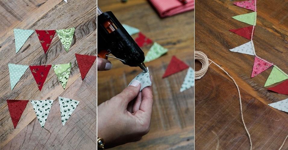 Use um molde de papel para cortar todas as bandeirinhas no mesmo tamanho. Depois fixe-as no barbante com a cola quente
