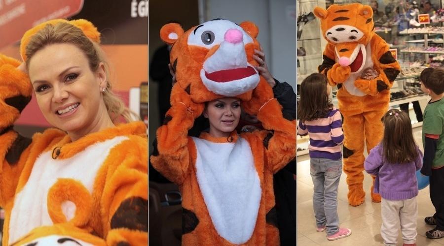 8.ago.2013 - Eliana se vestiu de tigre para gravar um quadro para seu programa. A apresentadora esteve em um shopping e brincou com algumas crianças