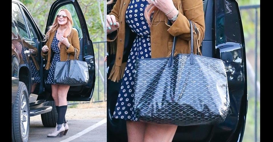Lindsay Lohan aparece com sua bolsa estilo