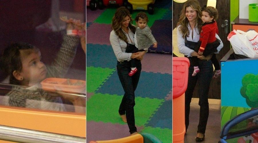 27.ago.2013 - Grazi Massafera passeou com a filha Sofia em um shopping da zona oeste do Rio. A atriz brincou com a menina em um parquinho e chegou a tirar fotos com fãs. Grazi está no ar em
