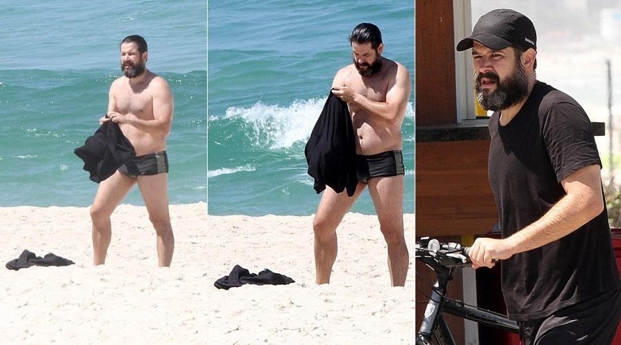 12.set.2013 - Barbudo, Murilo Benício curtiu praia na Barra da Tijuca, zona oeste do Rio. O ator exibiu a barriguinha fora de forma