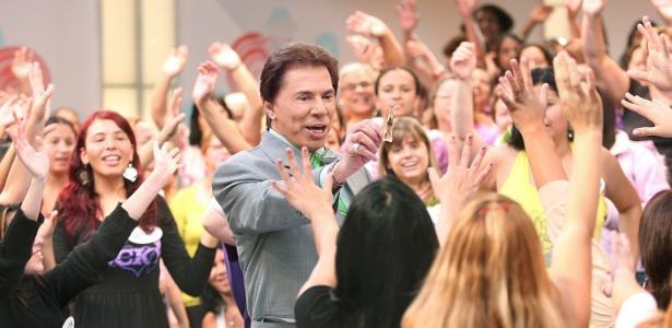 http://imguol.com/c/entretenimento/2013/09/30/2008---o-apresentador-silvio-santos-oferece-dinheiro-para-a-plateia-1380575803051_615x300.jpg