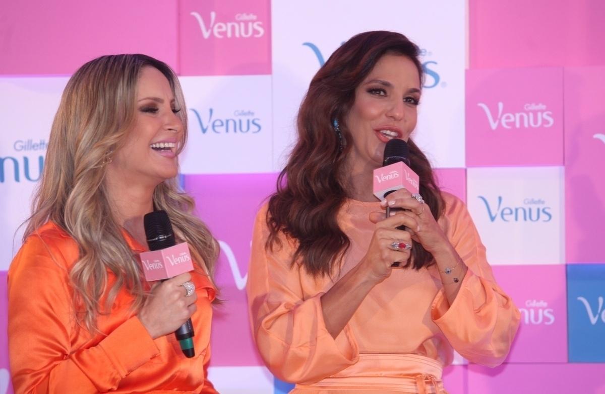 9.out.2013 - Claudia Leitte e Ivete Sangalo exibem bom humor no lançamento de campanha de um produto de beleza, no WTC Hotel, em São Paulo