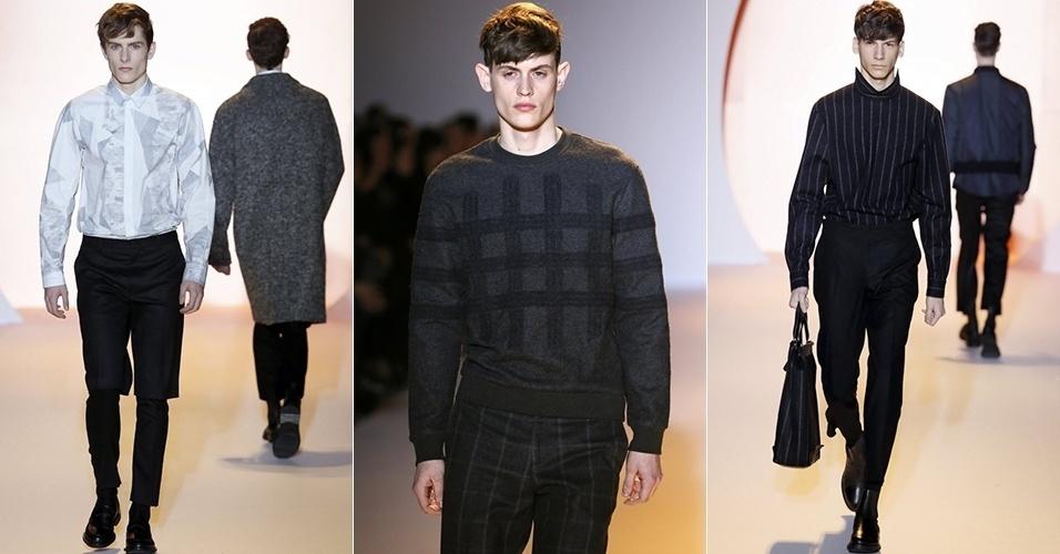 18 jan. 2014 - Modelos desfilam looks da Wooyoungmi para o Inverno 2014 durante a semana de moda masculina de Paris