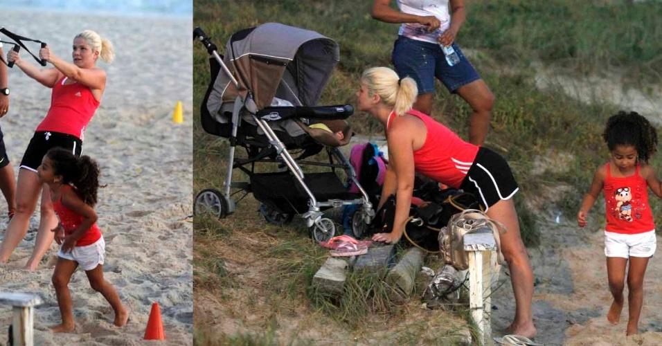 21-jan.2014- Samara Felippo se exercita em praia carioca na companhia das filhas Alicia e Lara