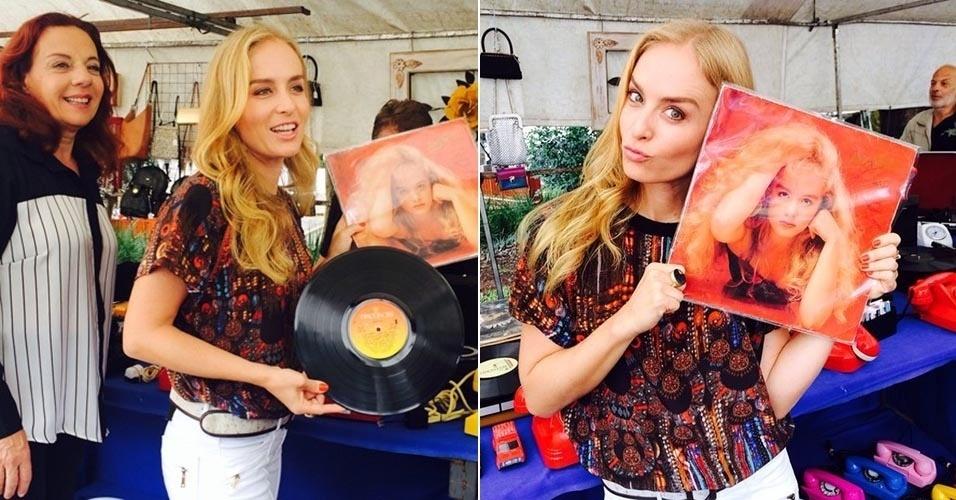 18.fev.2014 - Angélica encontrou um disco antigo seu ao passear em uma feira de antiguidades do bairro do Bixiga, em São Paulo, durante uma gravação para o