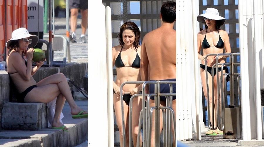 15.mar.2014 - Zezé Polessa curtiu praia no Leblon, zona sul do Rio. Aos 60 anos, a atriz exibiu a boa forma de biquíni preto