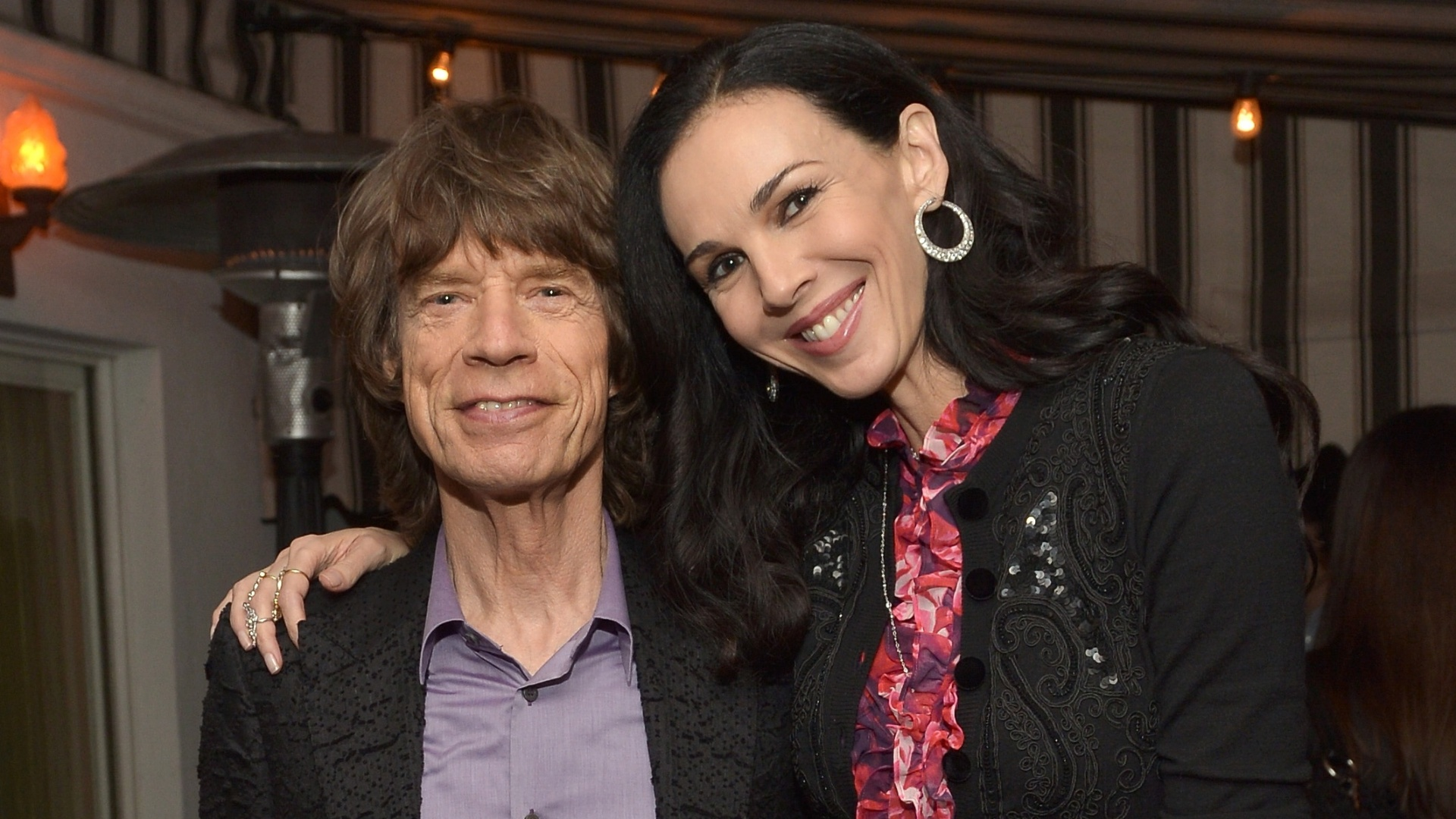 19.nov.2013 - Mick Jagger e L'Wren Scott em festa da Banana Republic, em Los Angeles