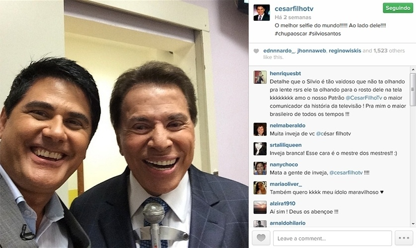 12.abr.2014 - Bem humorado, o jornalista César Filho faz selfie com Silvio Santos e brinca com a selfie tirada por vários famosos no Oscar 2014.