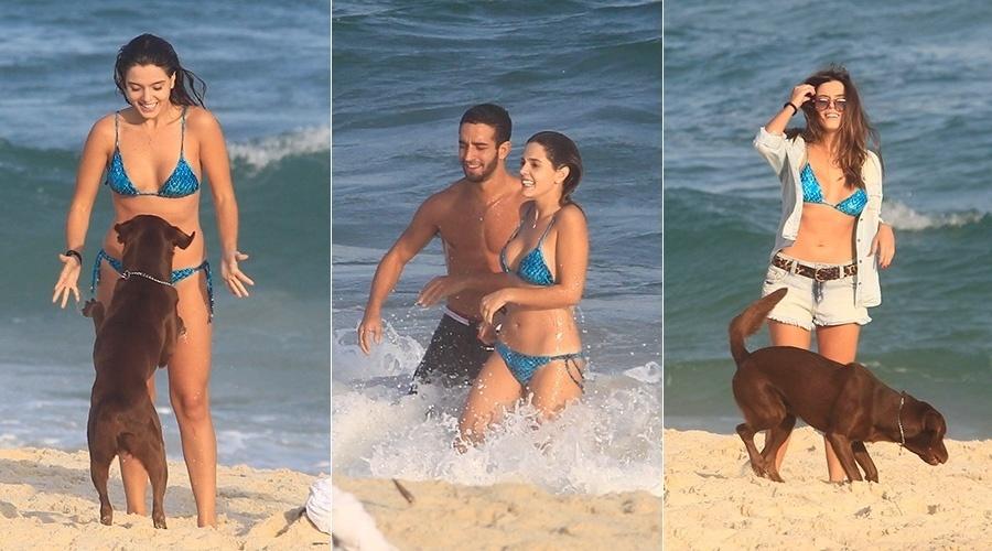 21.mai.2014 - Giovanna Lancellotti se divertiu com um cão na praia da Barra da Tijuca, zona oeste do Rio. A atriz estava acompanhada de um amigo e exibiu a boa forma. Giovanna está escalada para a novela