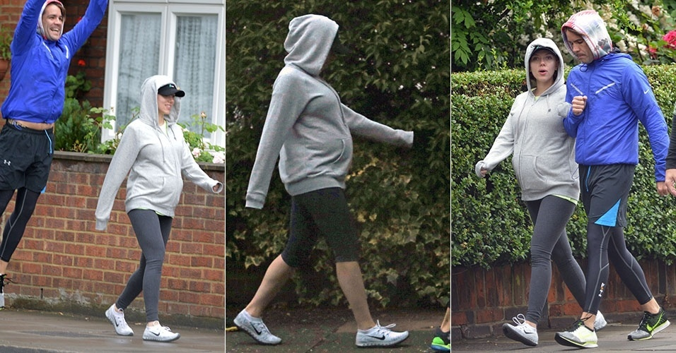 2.jun.2014 - Scarlett Johansson sai para passear com o noivo Romain Dauriac em Londres e deixa à mostra sua barriga de grávida
