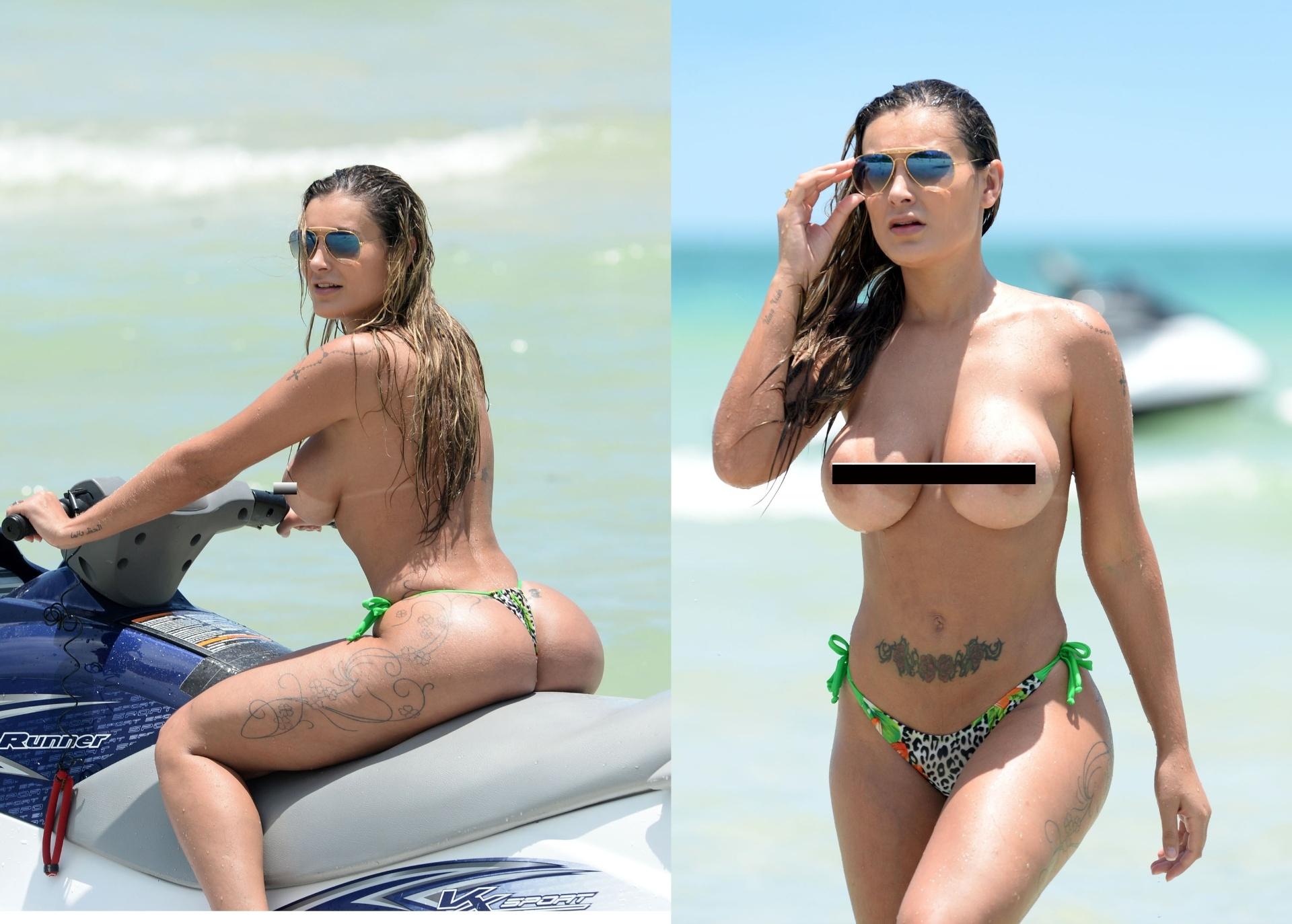13.jun.2014- Andressa Urach, que ganhou destaque no mundo após afirmar que teve um caso com o jogador português Cristiano Ronaldo, chama a atenção ao andar de jet ski, em uma praia de Miami, fazendo topless e com um pequeno biquíni fio-dental