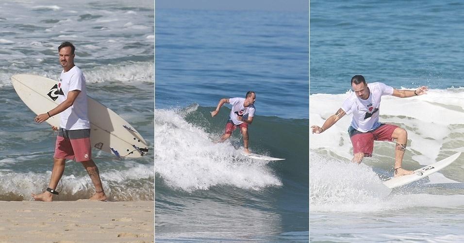 16.jul.2014 - Paulinho Vilhena aproveitou o dia de sol no Rio de Janeiro para surfar na praia do Recreio dos Bandeirantes