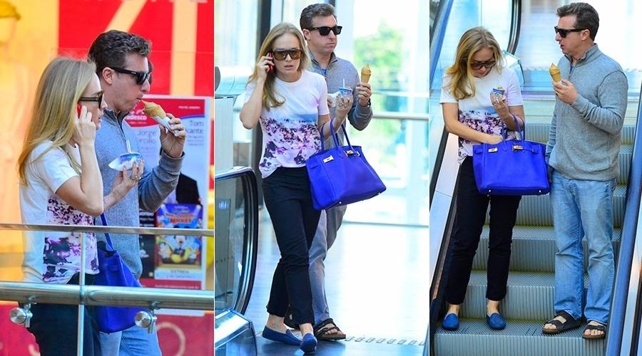 17.jul.2014 - Angélica e Luciano Huck passearam em um shopping da zona oeste do Rio. O casal se deliciou tomando sorvete