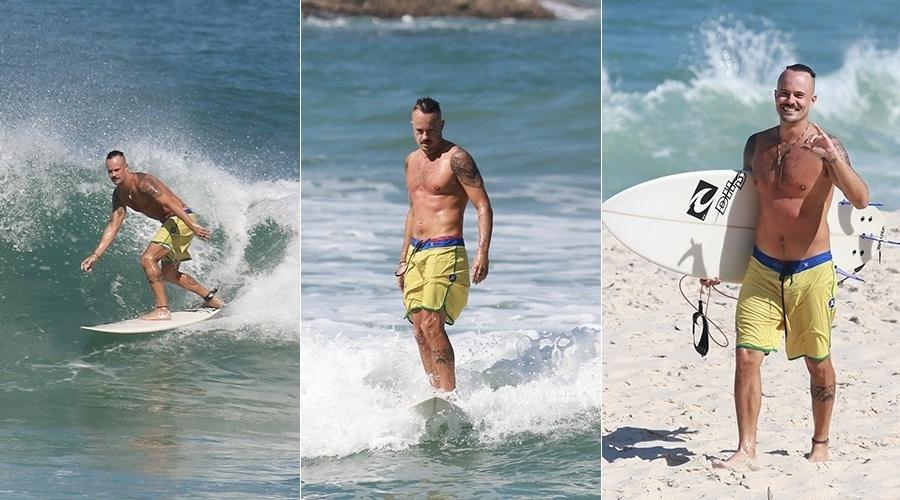 12.ago.2013 - Paulinho Vilhena aproveitou esta terça-feira para surfar em uma praia da zona oeste do Rio. Simpático, o ator sorriu ao ser fotografado pelo paparazzo