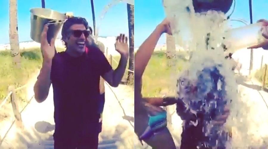 22.ago.2014 - Reynaldo Gianecchini também entrou na campanha do balde de gelo