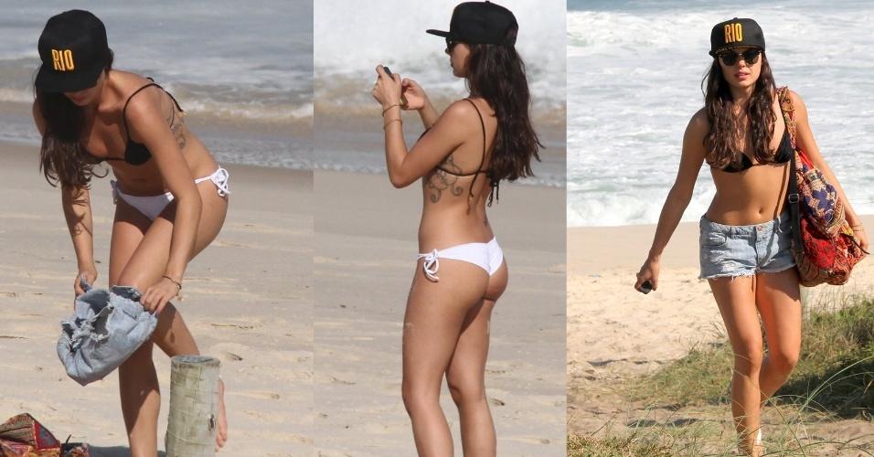 22.ago.2014- Isis Valverde aproveita sol de inverno na praia da Reserva, zona oeste do Rio. A atriz, que está no ar em