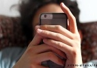 Aplicativo testa limites entre vigiar e proteger a família - picture-aliance/DPA/K. Hildebrand