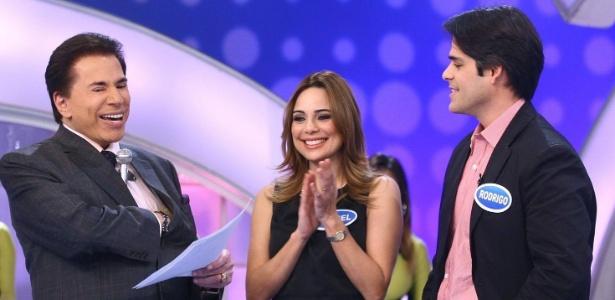 """2011 - Rachel Sheherazade com o marido, Rodrigo Porto, no """"Programa Silvio Santos"""""""