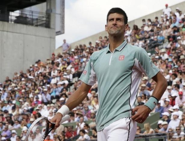 05.jun.2013 - Novak Djokovic comemora ponto durante a vitória sobre Tommy Haas nas quartas de Roland Garros