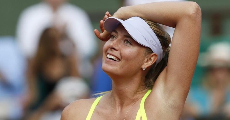 06.jun.2013 - Maria Sharapova sorri e mostra alívio ao conquistar a vitória sobre Victoria Azarenka nas semifinais de Roland Garros