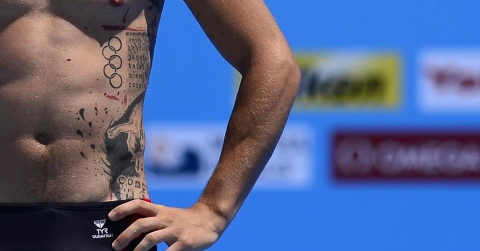 22.jul.2013 - O francês Matthieu Rosset, dos saltos ornamentais, tem tatuagem com os anéis olímpicos e com um saltador na lateral de seu tronco